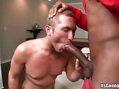 Naughty white fellow works his mouth at huge black dong.