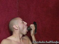 The dim lighting in this gay gloryhole is making this black dick that much darker. I can tell by the chair inside this place that bad things happen to good little boys like me. I can just smell the fresh cum still on the floor and walls of this place and