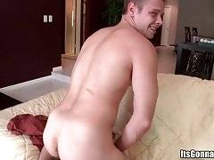 White dude sits on couch and passionately massages his boner.